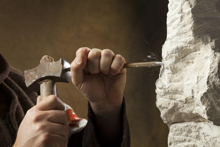 Stone carver's hand